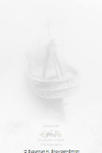 """Ghost Ship"" - The ex-USS Kittiwake appears as if from a ... by Susannah H. Snowden-Smith"